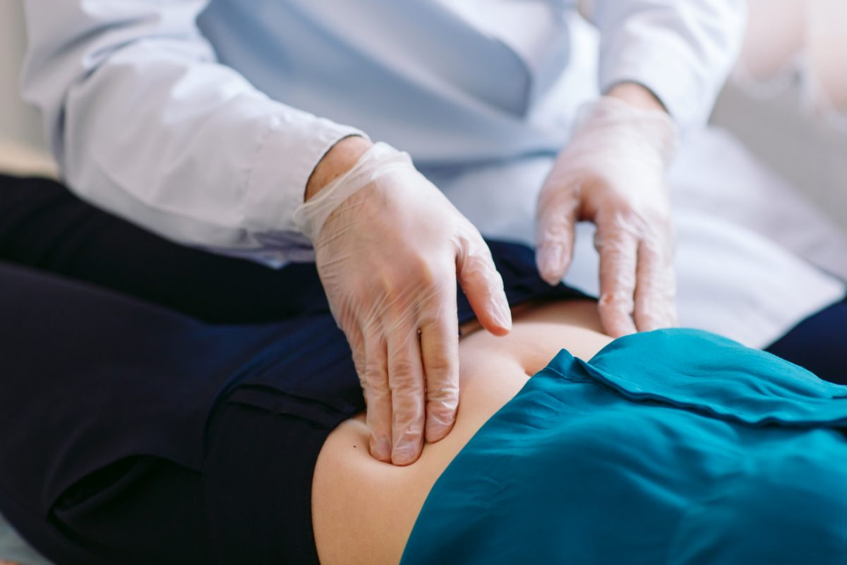 Gynecologist doing ultrasound scan in modern clinic